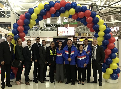 PAL's New York team, led by area manager Josh Vasquez (foreground, wearing company jacket),  with cabin crew before the inaugural flight. With Vasquez are Charisse Arboleda, Gina Arguelles, and Erwin del Rosario.