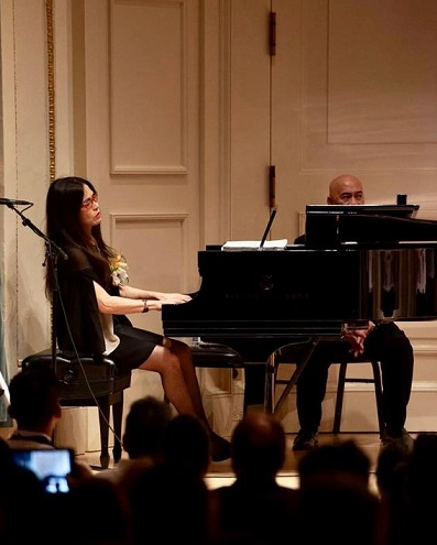 Classical pianist Cecile Licad tickles the keyboard in lieu of giving a speech.