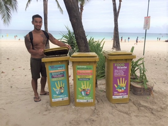 The author with trash bins in parts of the island.